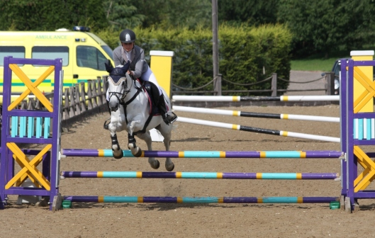 Libby Newman jumping for the Sussex Team going double clear