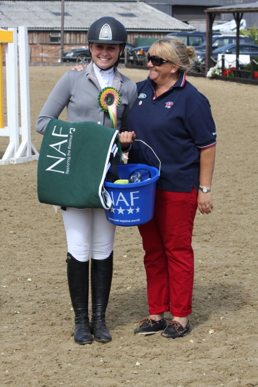 Libby receiving her prize from Corinne Bracken, British Showjumping Chef d'Equipe & Team Coach to the Junior & Young Rider Teams