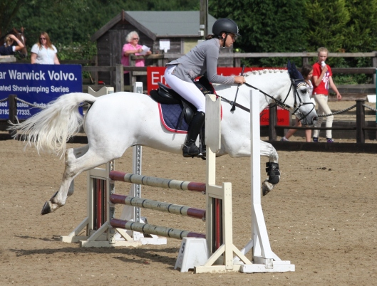 Libby Newman jumping in the Pony NAF 2* Competition